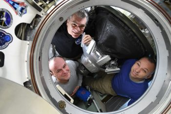 Clockwise from top: Paolo, Randy and Sergei in their spacecraft moments before closing the hatch. Credits: NASA
