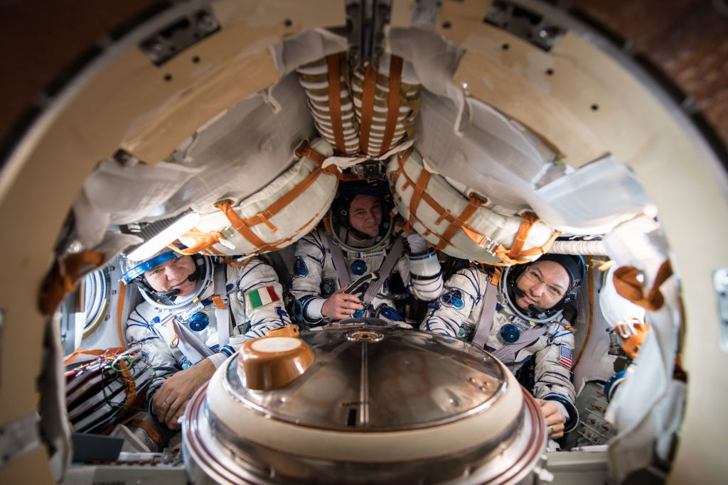 In their Soyuz spacecraft. Credirts: ESA/NASA