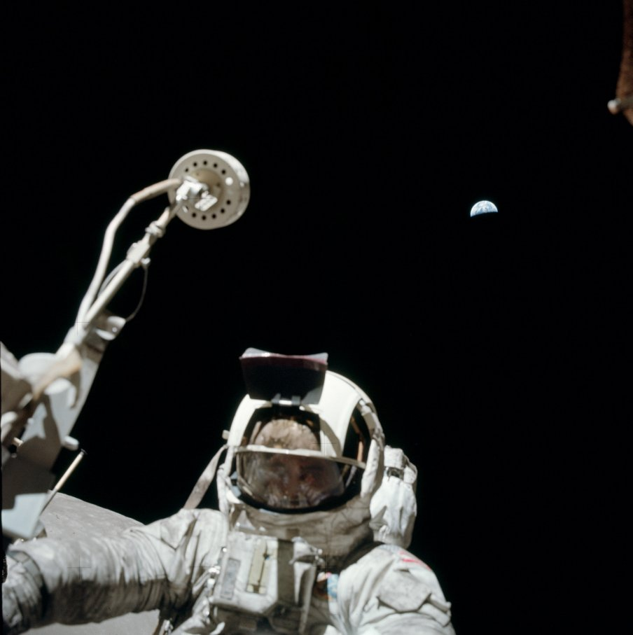 Apollo 17 astronaut on Moon with Earth in background. Credit: NASA