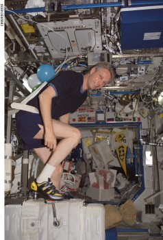 ESA-Astronaut Thomas Reiter excercising on board the ISS