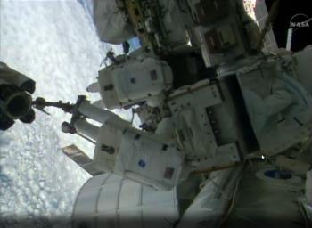 Installing pump module. Credits: NASA