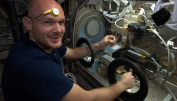 Alexander wearing Circadian Rhythm sensor while working with the Microgravity Science Glovebox. Credits: ESA/NASA