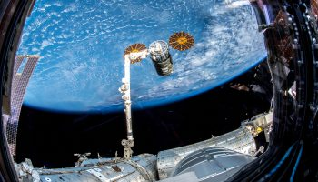 Cygnus grapple with robotic arm. Credits: ESA/NASA
