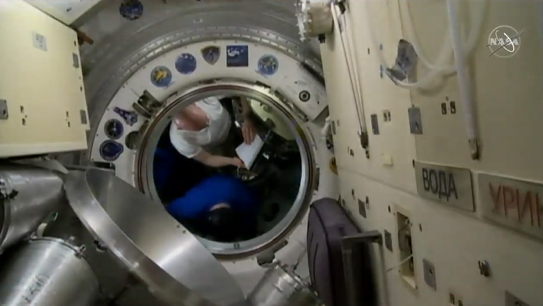 Alexander in the Soyuz before closing the hatch. Credits: NASA