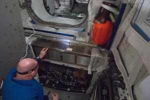 André Kuipers performs inspection and cleaning of Columbus ventilation systems (Credit: NASA)