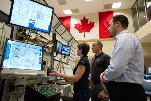 Working at the Robotic Work Station. The two monitors relate to the simulator and are not present on orbit. Instructos using to run the simulation  (Credit: CSA)