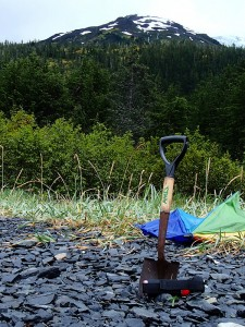 "The kit for the ""trip in the bush"".  A shovel to dig your toilet and pepper spray in case a bear heads your way."