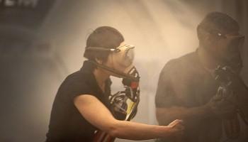 Discharging the fire extinguisher (Photo courtesy: Milo Sciaky)