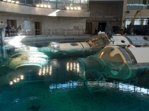 Replicas of the Russian ISS modules are lowered into the Hydrolab