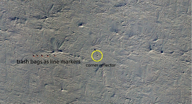 DMS image of one of the western end of the main survey grid showing garbage bag markers and corner reflector. (Dennis Gearhardt/DMS and Michael Studinger/NASA)