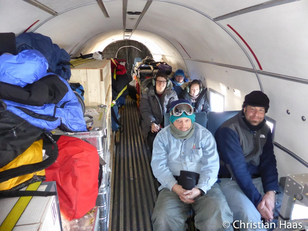 Part of the CryoVEx science team and all their equipment in the DC-3 used for airborne electromagnetic induction surveys. (Christian Haas)