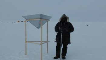 Measuring snow depth near the RADAR corner reflector in the 400m by 60m grid. (Christian Haas)