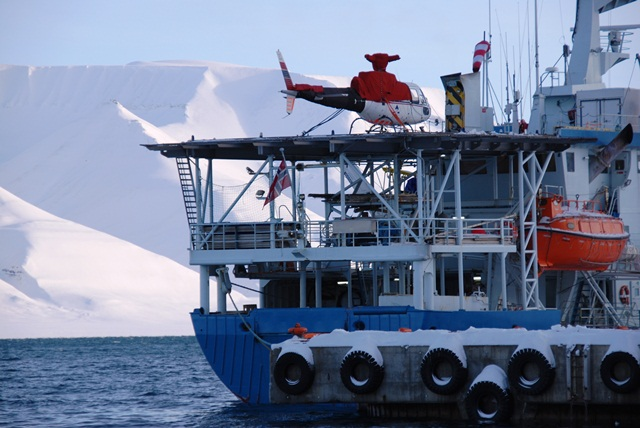 Helicopter, which carries the EM Bird sensor, on RV Lance in the harbor of Longyearbyen. (ESA)
