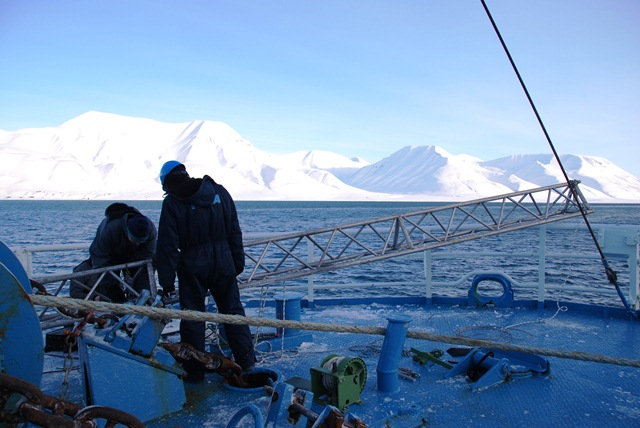 Scientists from Germany's HSVA preparing the mount for the ship-based electromagnetic sensor. (ESA)