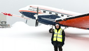 ESA's Tania Casal and Polar-5 snowbound in Svalbard. (Stefan Hendricks, AWI)