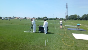 The group from Milan spraying plots. The plot as the back is visible with the white inert kaolin powder. On the right, the team from Luxembourg is preparing several calibration targets with known albedo. (ESA)