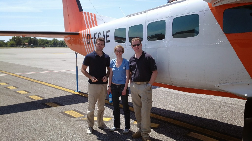 Operator Anke Schickling from FZ-Juelich with the two pilots before the start of the campaign. (ESA–Dirk Schüttemeyer)