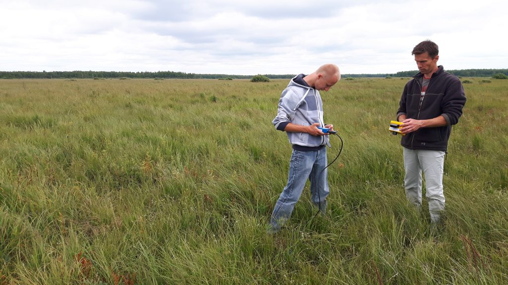 Taking similar measurements on the marshland site. (ESA)