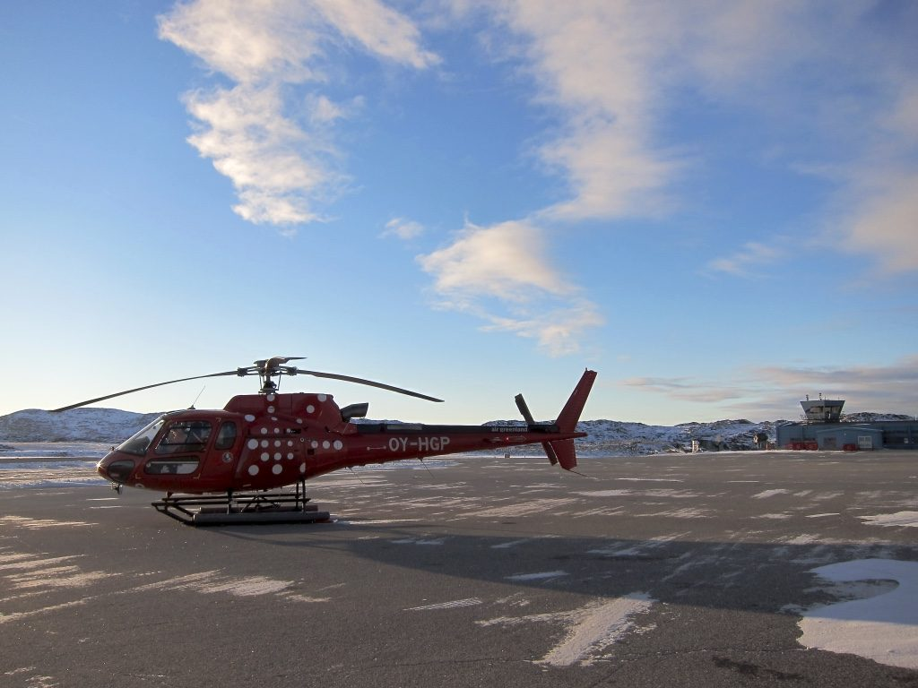 Air Greenland AS350 Écureuil helicopter jammed full with equipment departing for a day of measurements on ice sheet with Andy Shepherd and Anna Hogg aboard. (ESA)