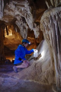 Collecting dripping water for paleoclimatic studies.  Photo: Alessio Romeo.