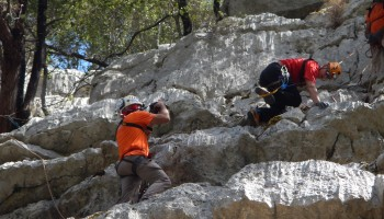 Riccardo De Luca taking pictures during the climbing training session.
