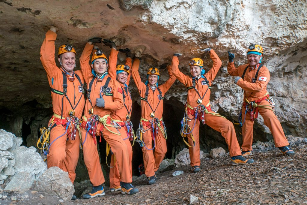 Last light before entering the caves. From left: Ricky Arnold, Ye Guangfu, Sergei Korsakov, Pedro Duque, Jessica Meir and Aki Hoshide. Credits: ESA–V. Crobu