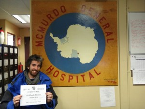 Alexander Kumar proudly holding his dental degree certificate at McMurdo General Hospital