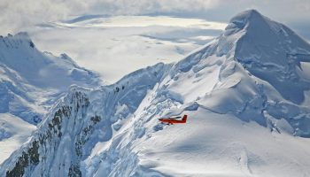 Basler plane and mountain peaks. Credits: British Antarctic Survey