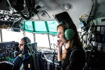 Beth in the cockpit on the way to Antarctica