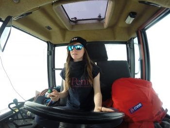 Beth and her I-pod in the tractor. Credits: ESA/IPEV/PNRA–B. Healey