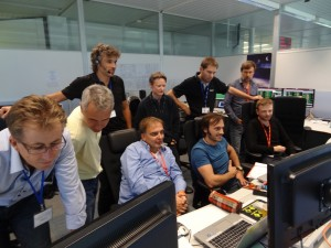 View of the teams in the Project Support Office at ESOC: the industrial team from Astrium GmbH in the Project Support Room (PSR) accompanied by ESA's Nic Mardle who is Swarm B-team Spacecraft Operation Manager. Credit: ESA
