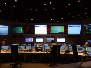 Flight Director's view of the front rows in the Main Control Room at ESOC, with the Spacecraft Operation Manager console position in the centre of the team. Credit: ESA