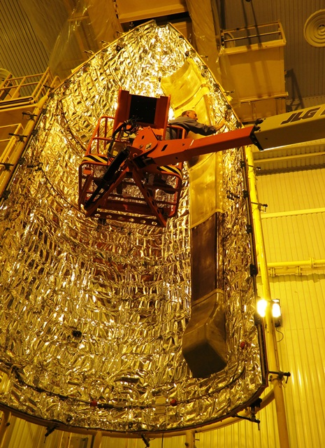Cleaning and installing the venting system in the Rockot fairing. (ESA/B. Bergaglio)