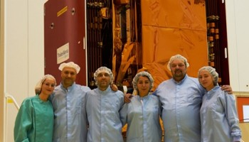 In the cleanroom: Veronique Bellardo (Thales Alenia Space), Marco Cesa, Adriano Carbone, Deniz Uestuener, Paul Snoeij and Julija Mataityte (all ESA). (ESA–B. v/d Elst)