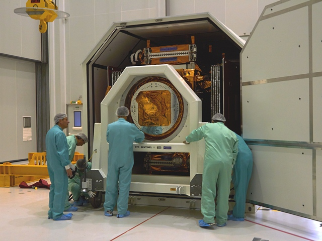 Taking Sentinel-1A out of transport container. (ESA –B. v/d Elst)