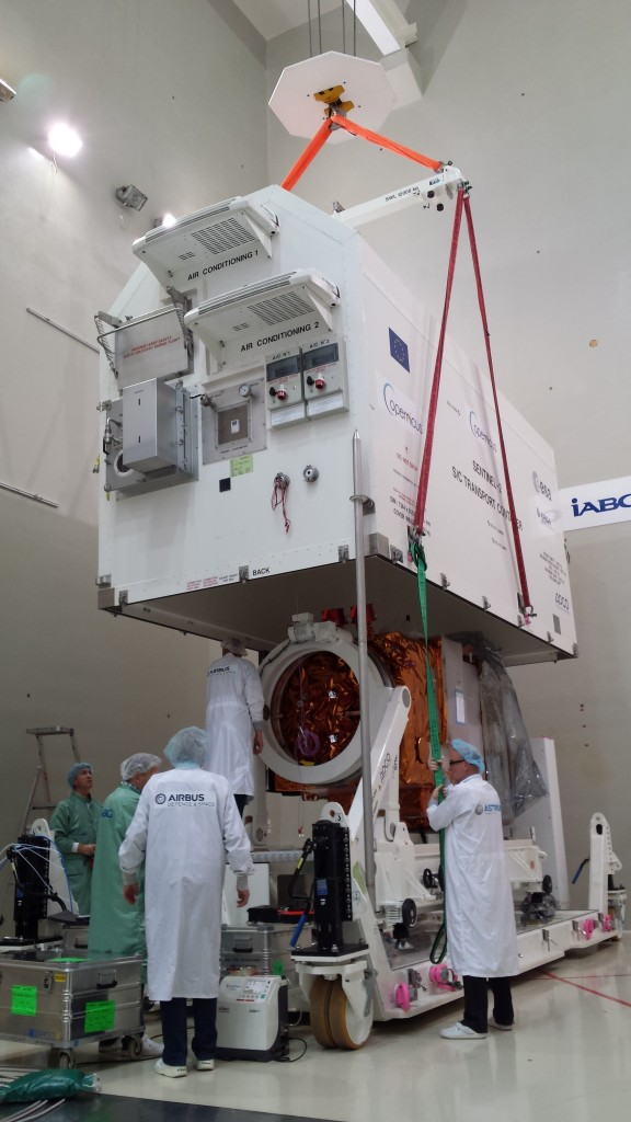 Shipment container being lowered over Sentinel-2A at IABG in Germany. (ESA–L. Cane)