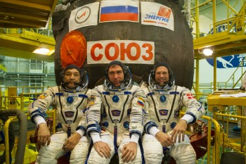 Aidyn, Sergei and Andreas in front of their Soyuz. Credits: GCTC