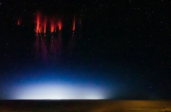 The red colour of the sprites is caused by nitrogen interacting with electricity in the upper atmosphere. Credit: Jason Ahrns
