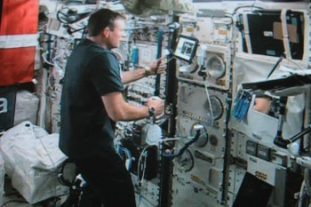 Andreas operating robot in space.