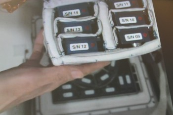 Japanese astronaut Kimiya Yui showing Endothelial Cells cassettes to camera in space. Credits: Col-CC cam