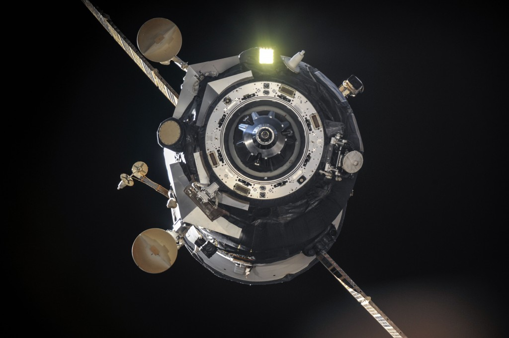 Progress leaves Station showing flood lights. Credits: NASA