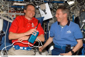 ESA astronaut Christer Fuglesang and Thomas Reiter on ISS with belt-worn radiation monitors. Credits: ESA/NASA
