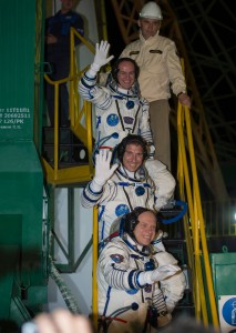 Expedition 37 in front of their  Soyuz TMA-10M rocket Credits NASA