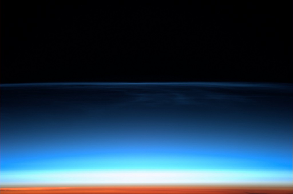 Mesospheric Noctilucent Clouds capture the first rays of a new day's sun