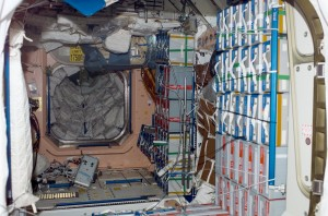 Unity module interior with PMA1 in the background. Credits: NASA