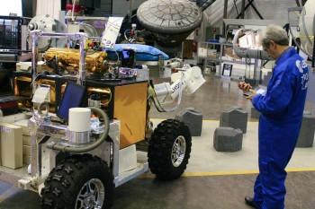 ESA astronaut Léopold Eyharts with Eurobot robot during simulation. Credits: ESA