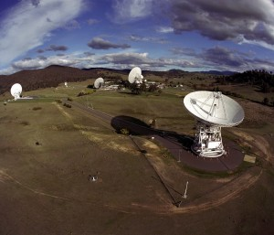 View of the Canberra Complex showing the 70m (230 ft.) antenna and the 34m (110 ft.) antennas. Located outside Canberra, Australia, DSN Canberra is one of the three complexes which comprise NASA's Deep Space Network. The other complexes are located in Goldstone, California, and Madrid, Spain. Credit: NASA