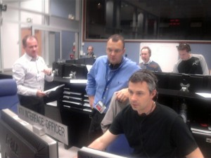 ATV Mission Director Kris Capelle (blue shirt) monitors the test with Flight Director Cedric Delmas (seated)