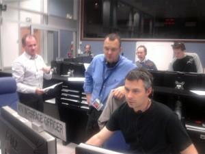 ATV Mission Director Kris Capelle (blue shirt)