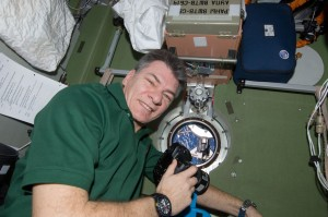 ESA's astronaut Paolo Nespoli, Expedition 26 flight engineer, uses a still camera at a window in the Zvezda Service Module during rendezvous and docking shuttle Discovery, 26 February 2011. Credits: ESA/NASA